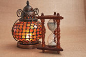 Old oriental lamp and hourglass — Stock Photo