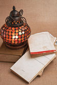 Old oriental lamps and old books — Stock Photo