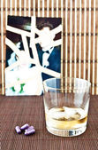 Glass of alcohol and pills — Stock Photo
