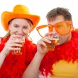 Two Dutch soccer fans in orange outfit cheering for the WK games — Stock Photo
