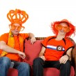 Two Dutch soccer fan watching game — Stock Photo