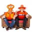 Two Dutch soccer fan watching game — Stock Photo #5428883