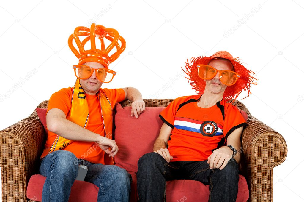 Two Dutch soccer fan watching game over white background — Stock Photo #5428873