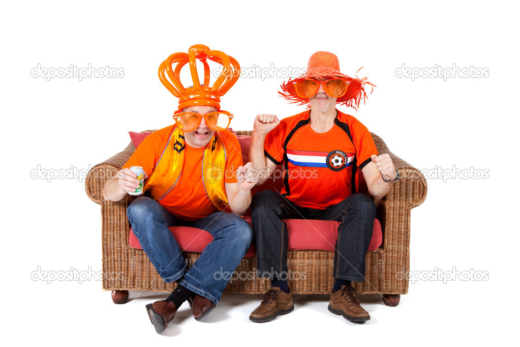 Two Dutch soccer fan watching game over white background — Stock Photo #5428883