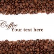 Coffee beans over white with text space - Stock Photo