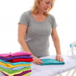 Housewife folding clothes — Stock Photo