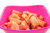 Bowl with cubes raw salmon — Stock Photo