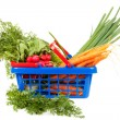 Shopping basket filled with healthy vegetables — Stock fotografie