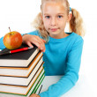 Back to school: girl with pile of books — Stock Photo