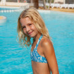 Постер, плакат: Girl in bikini by swim pool