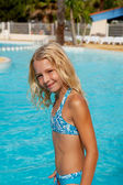 Girl in bikini by swim pool — Foto de Stock