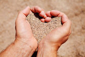 Hands filled with sand — Stock Photo