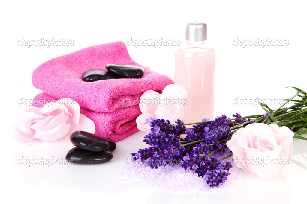 Spa accessory with pink towels, black stapping stones and lavender flowers — Stock Photo #5885770