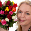 Portrait of woman with bouquet of roses — Stock Photo #5919270