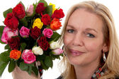 Portrait of woman with bouquet of roses — Stock Photo