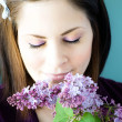 Young woman smelling lilacs — Stock Photo