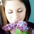 Young woman smelling lilacs — Stock Photo #5830969