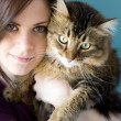 Young woman with pet cat - Stock Photo