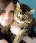 Young woman with pet cat — Stock Photo