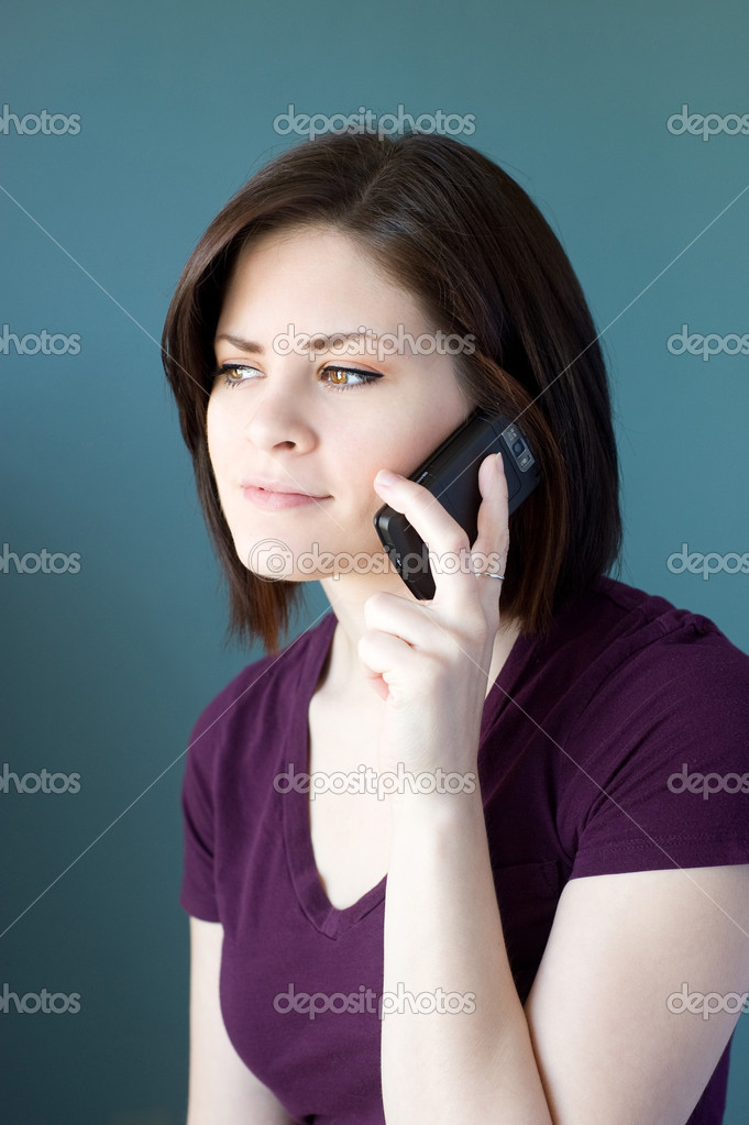 A young woman talking on the phone. — Stock Photo #6050126