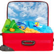 Travel red suitcase packed for summer vacation — Stock Photo
