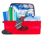 Travel blue business suitcase packed for trip — Stock Photo