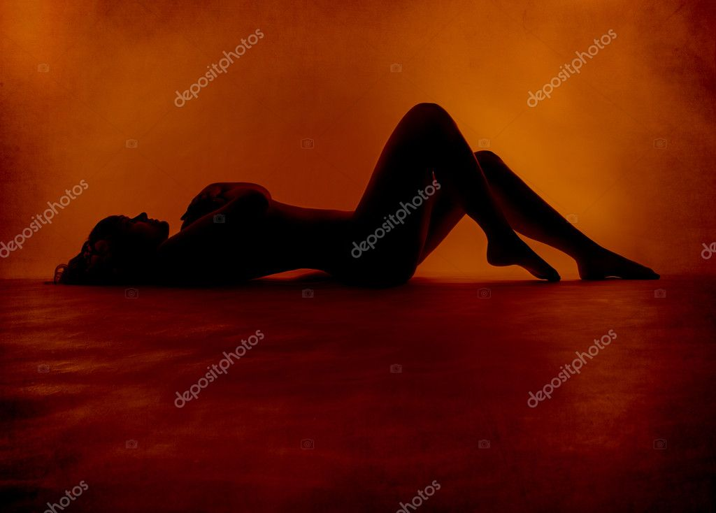 Naked sexy woman silhouette lying at red orange background — Stock Photo #5561758