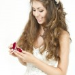 Bride holding red box with golden wedding rings. Smiling and loo — Stock Photo