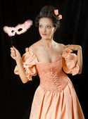 Stylized rococo portrait of woman in historical costume with cri — Stock Photo