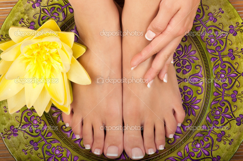 Pedicure and manicure spa with beautiful flowers — Stock Photo #6453525