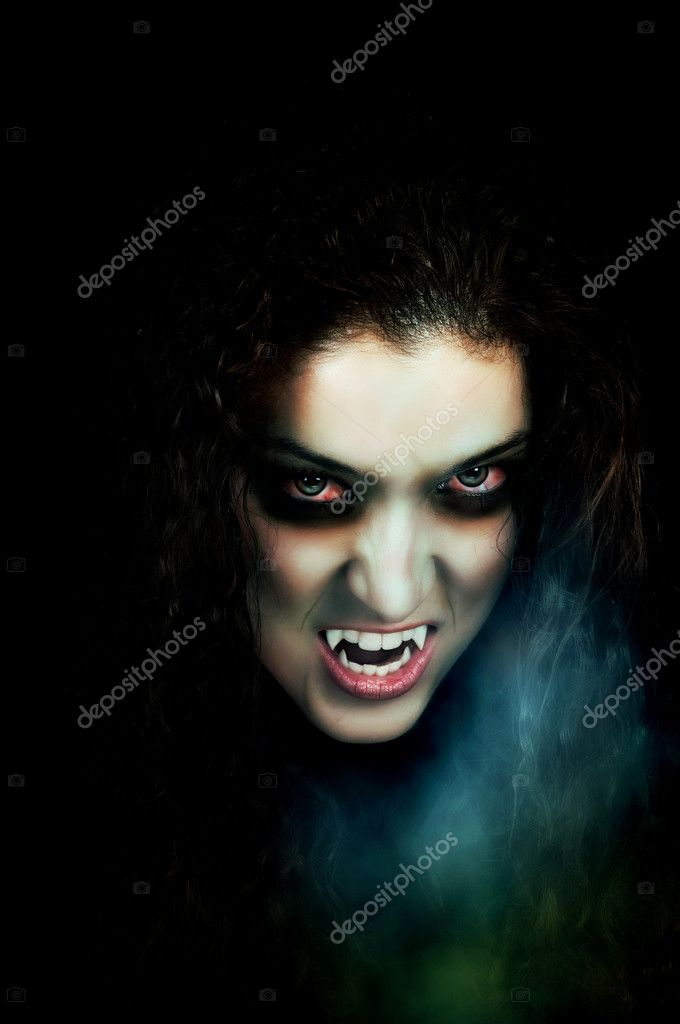 Vampire with pale face, fangs, flaky skin and scary eyes   Stock Photo #6453546