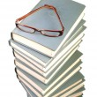 Stack of books and eyeglasses — Stock Photo