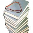 Stack of books and eyeglasses - Stock Photo