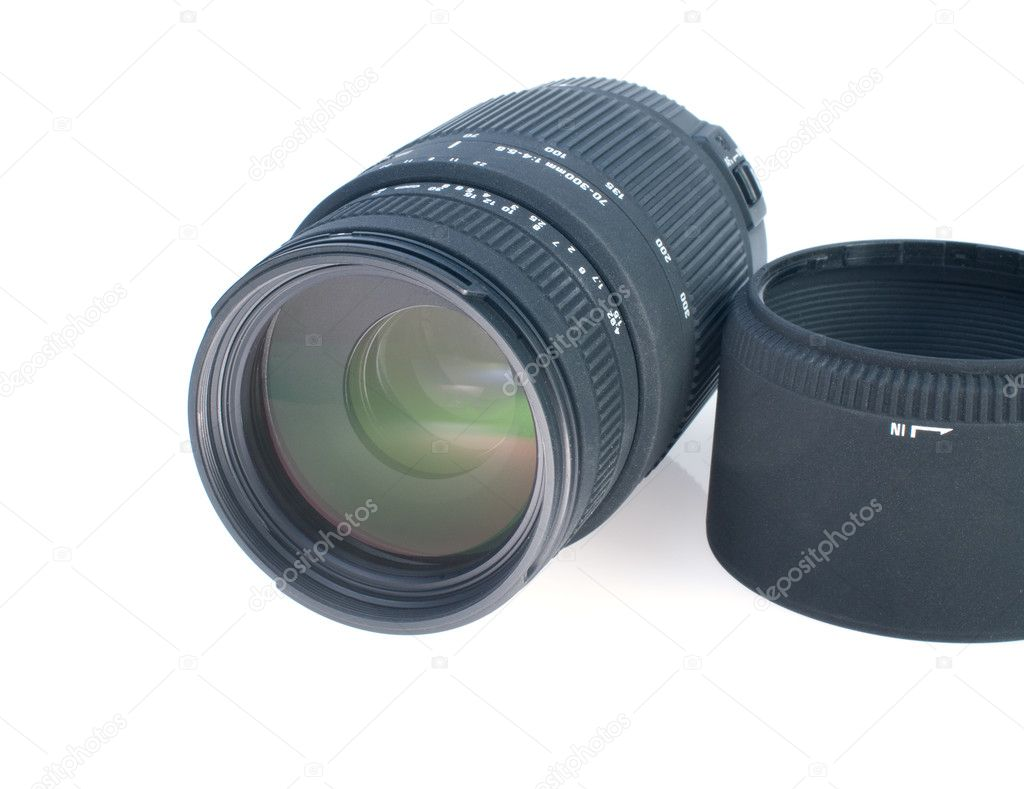 Zoom camera lens and reflected on the white background — Stock Photo #6654232