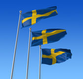 Flags of Sweden against blue sky. — Stock Photo
