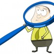 Royalty-Free Stock Photo: Man with big magnifying glass