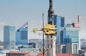 Weathercock against high-rise buildings in Tallinn, Estonia. — Stock Photo