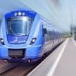Blue train in motion — Stock Photo #6600410
