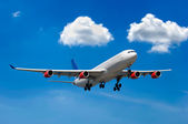 Big airliner and clouds — Stock Photo