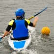 Man playing kayak polo — Stock Photo