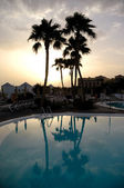 Sunset and pool — Stockfoto