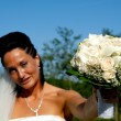 Bride with flower bouquet — Stock Photo