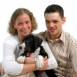 Royalty-Free Stock Photo: Young happy couple and puppy
