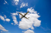 Plane and clouds — Stockfoto