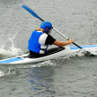 Man racing in kayak — Stock Photo