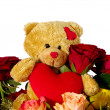 Teddy bear whit flowers and heart — Stock Photo