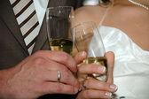 Wedding couple and champangne — Stock Photo