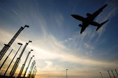 Airport, plane and sunset — Stock Photo