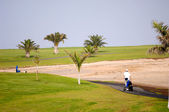 Golfer walking — Stockfoto
