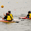 In kayak playing polo — Stock Photo